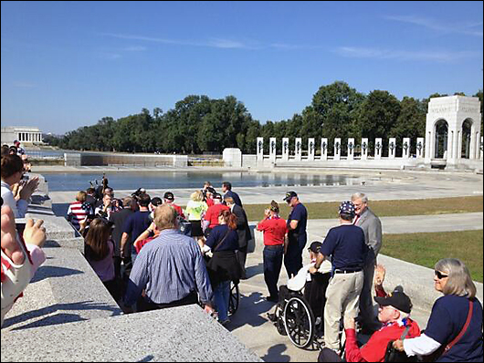 honor flight vets storm world war 2 memorial