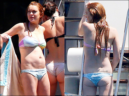 lindsay lohan looking sloppy fat on a yacht