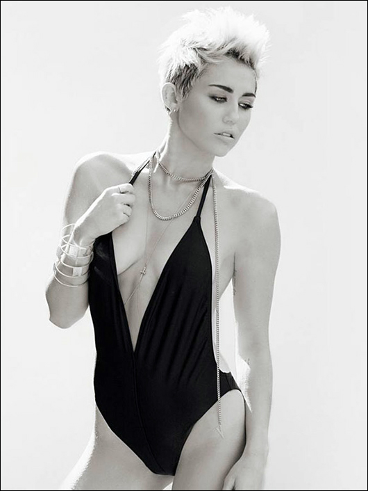 miley cyrus one-piece cleavagey